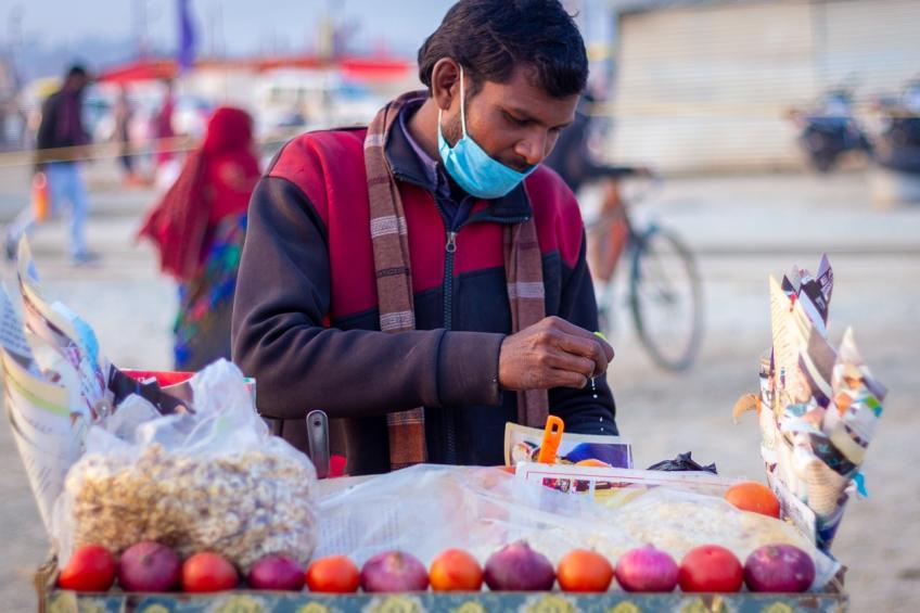 A snacks seller at Sangam, Prayag, January 2021